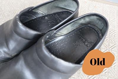 ダンスコのプロフェッショナルの黒の古い靴の内側のかかと部分の写真