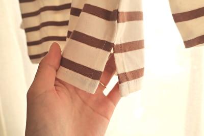 ZARABABYの4-5歳(110㎝)サイズの茶色と白のボーダー柄長袖の裾のカットの部分